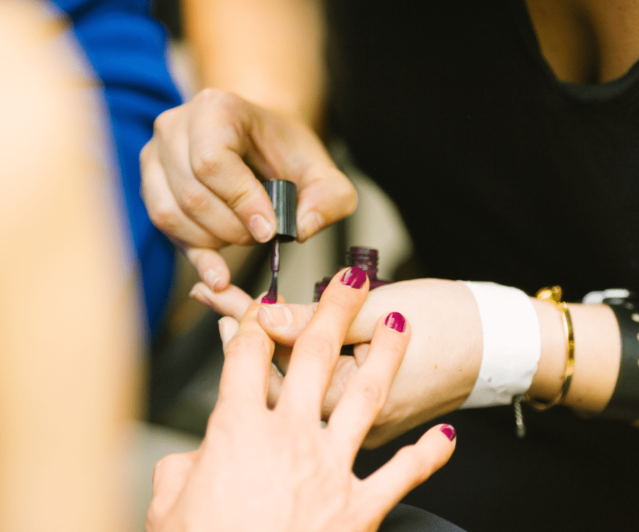 Women get her nails painted at a salon which is an ideal gift for new moms