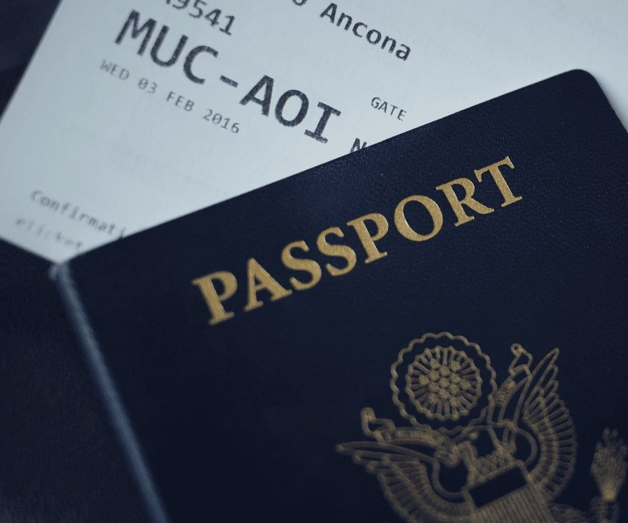 A passport with an airline ticket indicating retired dads should travel more