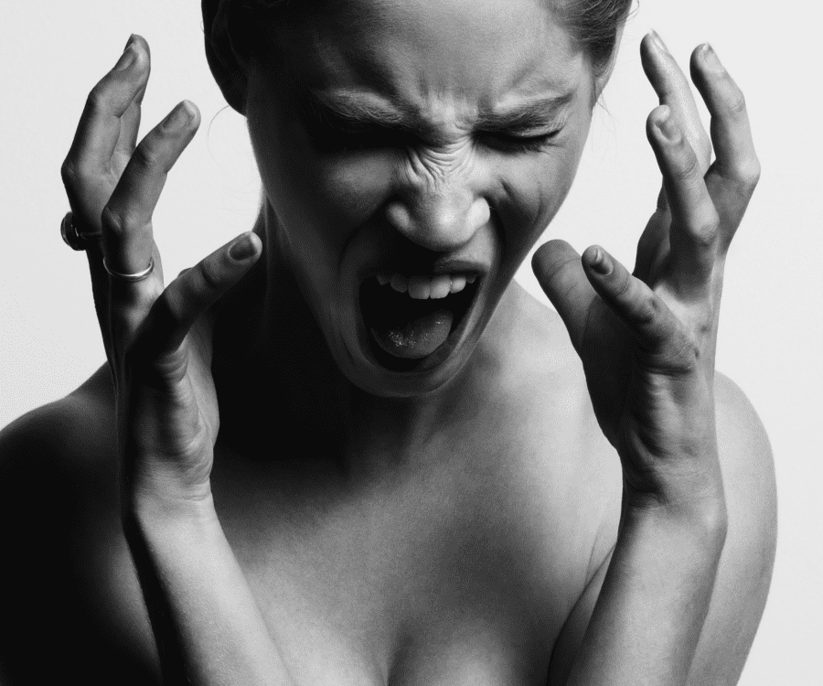 Frustrated women shouting with her hands next to her head